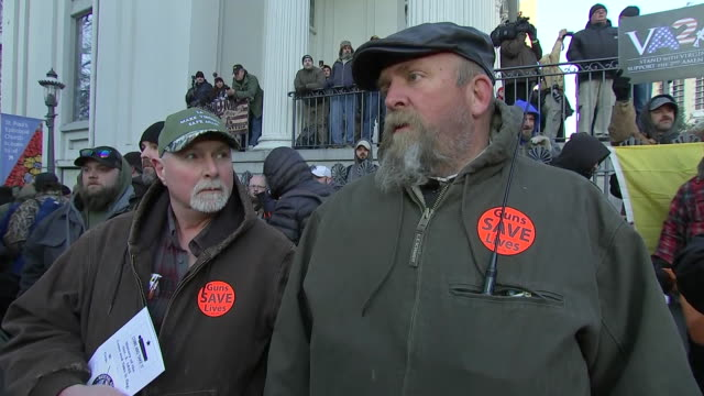 two men respond to a question about increased gun ownership restrictions during a gun rights rally in richmond, virginia. - mos stock videos & royalty-free footage