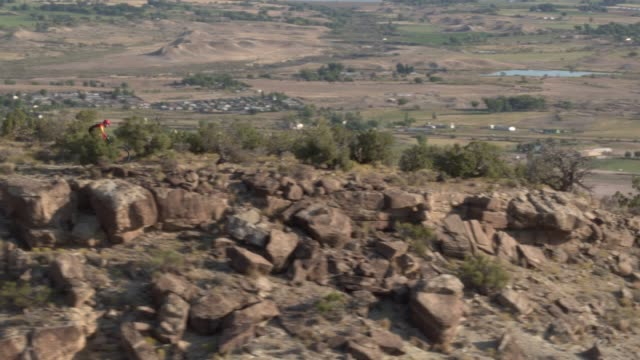 two men ride mountain bikes in a desert - trail ride stock videos and b-roll footage