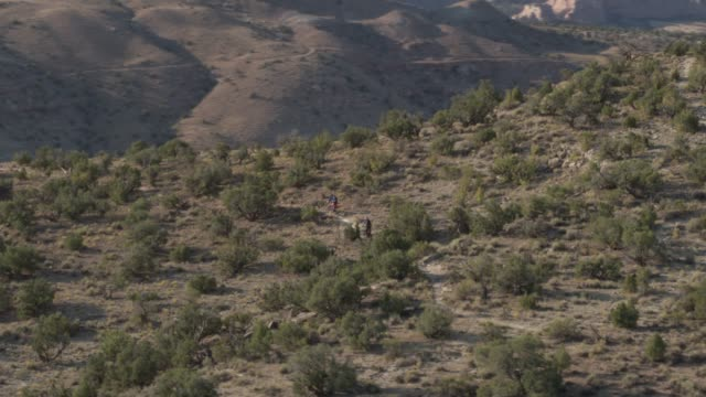 two men ride mountain bikes in the desert - trail ride stock videos and b-roll footage