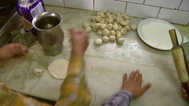 two men rolling out dough with rolling pin - rolling pin stock videos & royalty-free footage