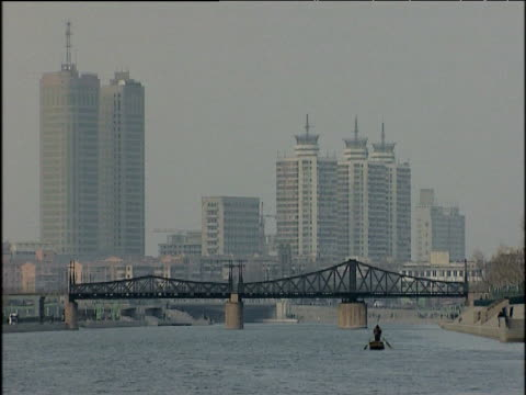 two men row along hai he river tianjin china; 2005 - hai river stock videos & royalty-free footage