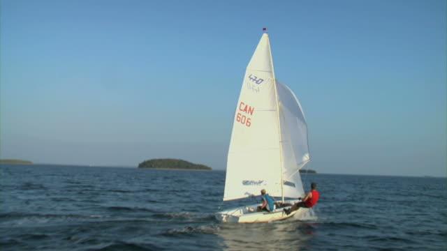 WS DS Two men sailing through sea / Chester, Noviscocia, Canada