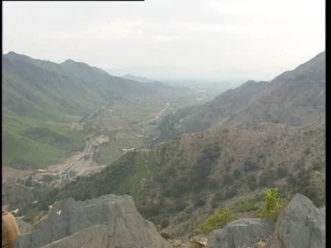two men sit and look out over the swat valley, pakistan. - pakistan video stock e b–roll