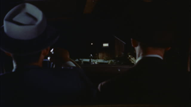vidéos et rushes de ms ts two men sitting in front seat of car and car reaching to old country store  - 1950 1959