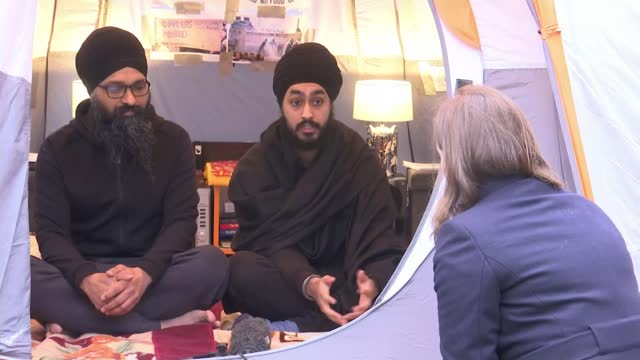 two men sleeping in tent in their back garden in solidarity with farmers protest in india; england: london: hayes: ext gurpreet singh dhindsa and... - itv london lunchtime news stock videos & royalty-free footage