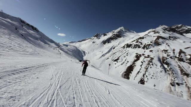 two men snowboarding and skiing in ski resort - skiurlaub stock-videos und b-roll-filmmaterial