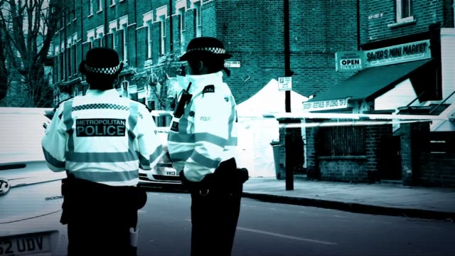 stockvideo's en b-roll-footage met two men stabbed to death in camden england london camden kentish town film various shots of police officers at scene of stabbing - kentish town
