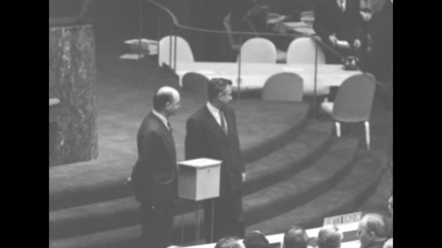 two men stand beside ballot box as representatives of member nations come to cast votes for president of the un general assembly most shake hands... - cast member stock videos and b-roll footage