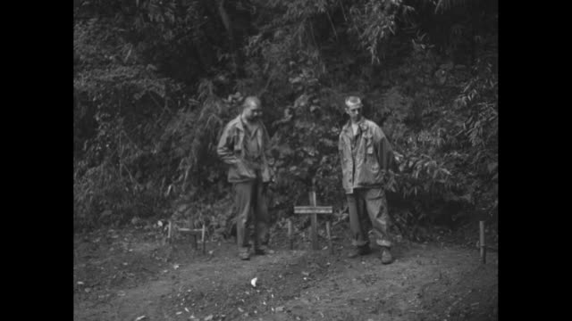 ls two men stand by wooden crosses / cu men stand by cross / ecu cross with japanese characters / man kneels by cross / note exact day not known - prisoner of war stock videos & royalty-free footage
