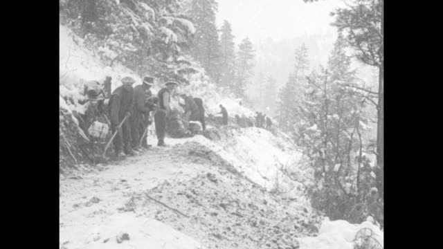 vídeos y material grabado en eventos de stock de two men standing next to well where gold was found near mancos, mountains in background / three shots of line of workers in snowstorm building road... - estados unidos del oeste
