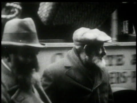 1913 montage two men standing on a city street / new york, new york, united states - 1913 stock-videos und b-roll-filmmaterial