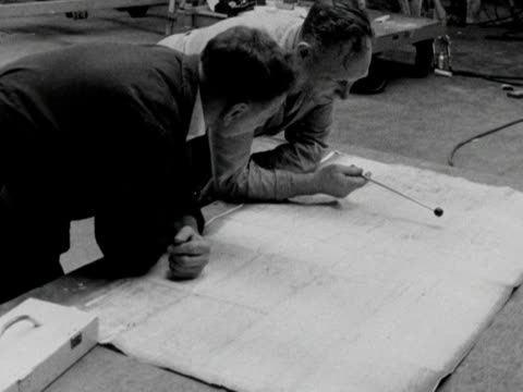 two men study the plans of a vc10 aircraft at the vickers factory. 1963. - air vehicle stock-videos und b-roll-filmmaterial