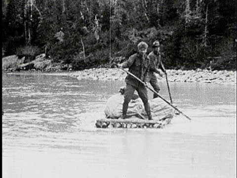 1926 b/w, ms, composite, two men swimming down river on wooden raft, alaska - 1926 stock videos & royalty-free footage