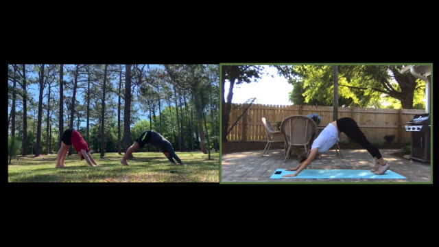 two men take a yoga class online - sun salutation stock videos & royalty-free footage