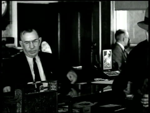 two men talking about election washington dc capitol building us treasury checks being auto signed mr ickes at desk angle on ws white house ms white... - 1932 stock videos and b-roll footage