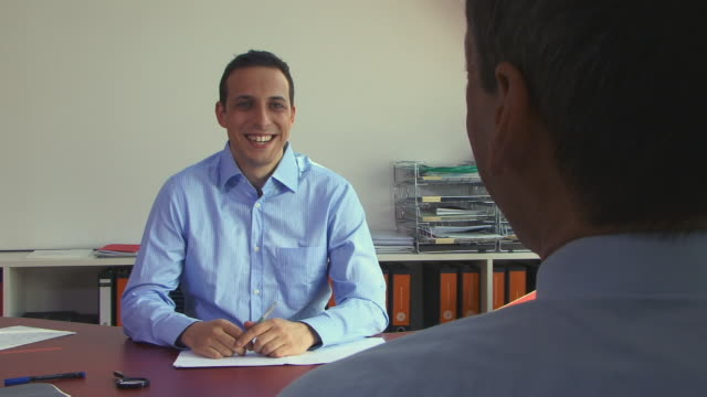CU, Two men talking in office, Berlin, Germany