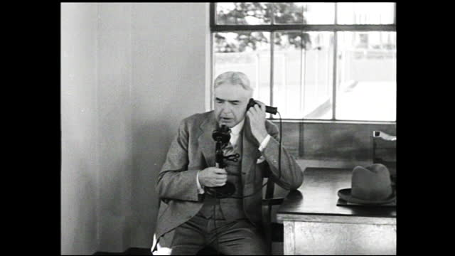 vidéos et rushes de two men talking interrupted by another man; intercut between two men communicating through the telephone; airplane flying in the sky - 1940 1949