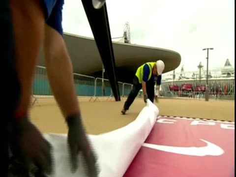 two men unroll a large poster for the paralympics - poster stock videos & royalty-free footage