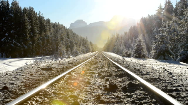 two men walk down snow covered railway tracks - rail transportation stock videos & royalty-free footage