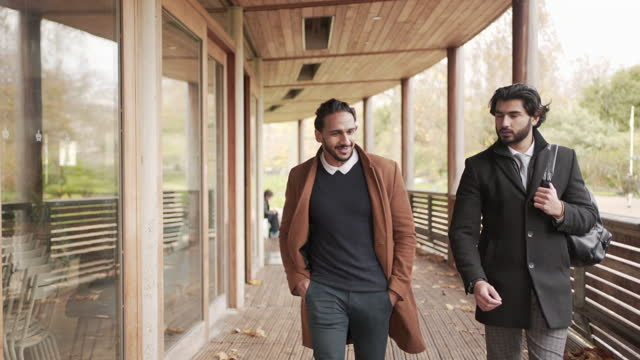 two men walking and chatting together - 20 29 years stock videos & royalty-free footage