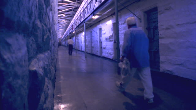 ws two men walking down corridor in folsom state prison / folsom, california, usa - jail cell stock videos & royalty-free footage