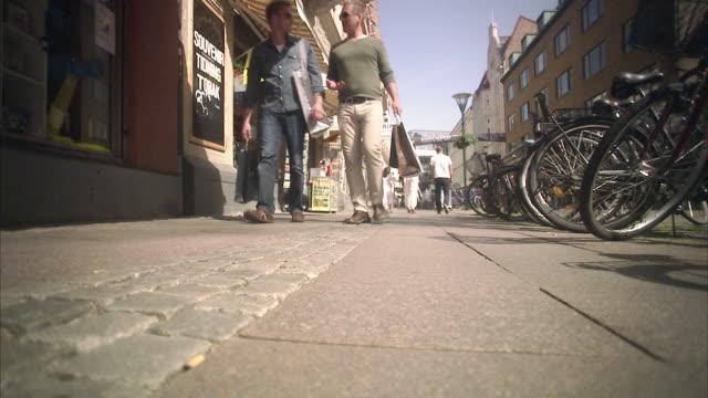 Two men walking in Malmo Skane Sweden.