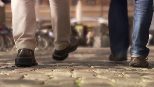 two men walking in malmo skane sweden. - rear view stock videos & royalty-free footage