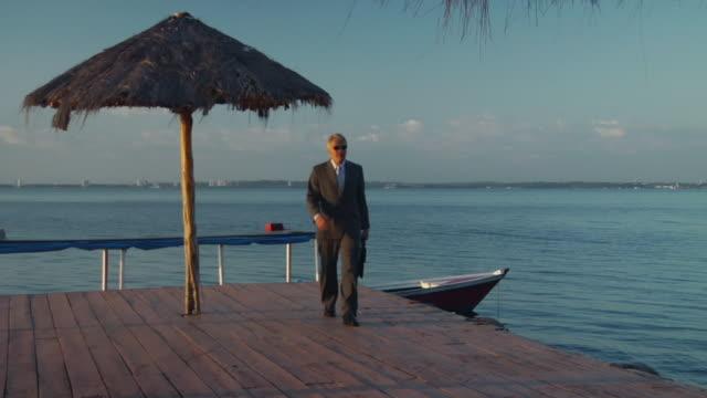 vidéos et rushes de ws, ms, two men walking on deck, manaus, brazil - porte documents
