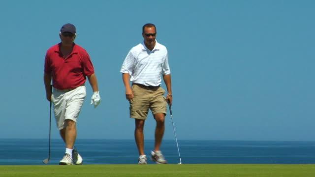 vídeos de stock e filmes b-roll de ms, two men walking on golf course, north truro, massachusetts, usa - golf