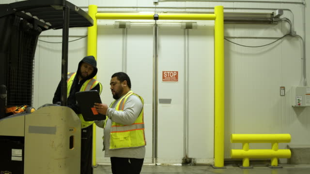 Two men working in a warehouse