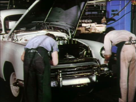 1951 two men working on car headlights in car assembly line / chevrolet - 1951 stock videos & royalty-free footage