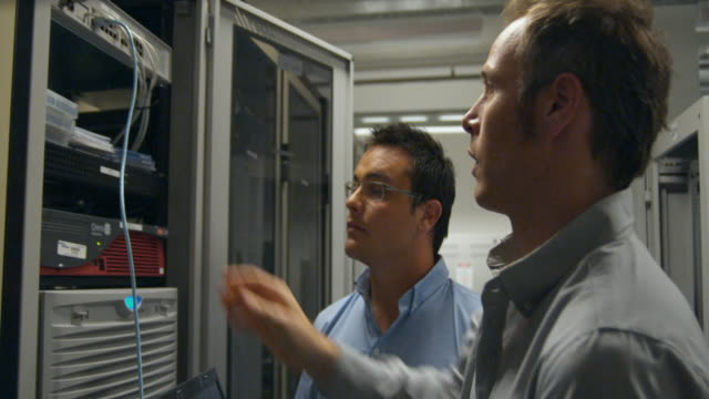 ms two men working on server in server room, sydney, australia - adjusting stock videos and b-roll footage