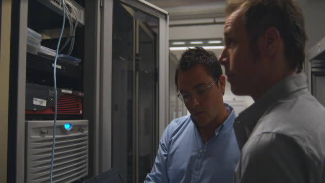 MS DS, Two men working on server in server room, Sydney, Australia