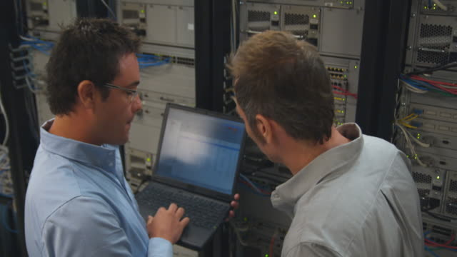 MS Two men working on server, Sydney, Australia