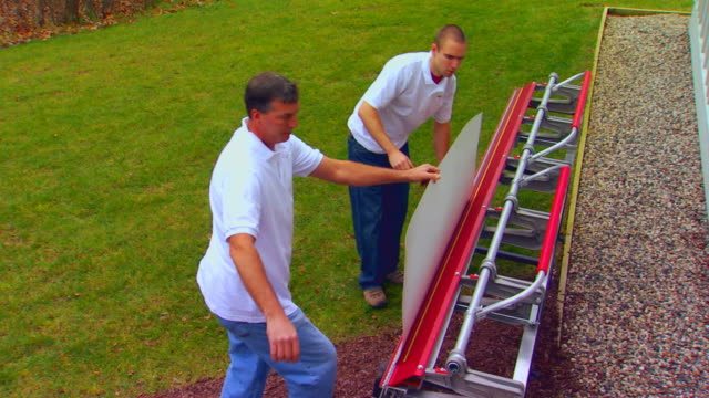 two men working with sheet metal and a special machine - sheet metal stock videos and b-roll footage