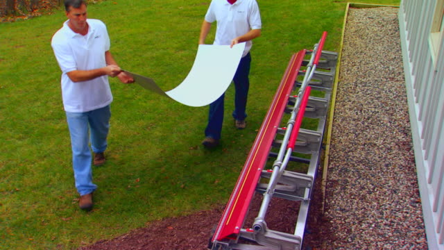 two men working with sheet metal and special machine - sheet metal stock videos and b-roll footage