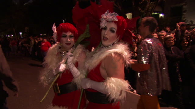 ms tu td two men's in drag christmas costumes poses and waving during high heel race in dupont circle / washington, dist. of columbia, united states - drag queen stock videos and b-roll footage