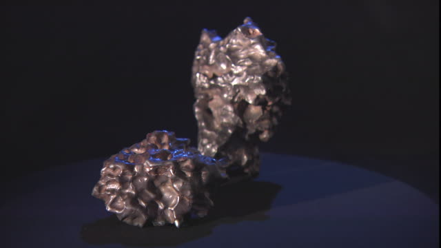 two meteorites rotate on a turntable. - payson stock videos & royalty-free footage
