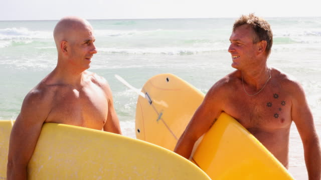 Two Middle Aged Men With Malibu Longboard Surfboards