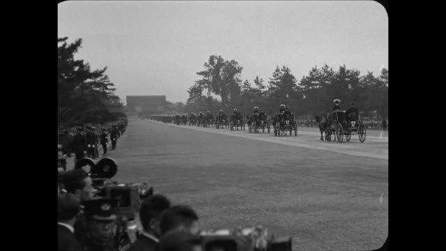 two mile pocession bears new japanese ruler to throne / toyko japanemperor hirohito leaves his palace on way to coronation ceremonies / emperor... - 1928 stock videos & royalty-free footage