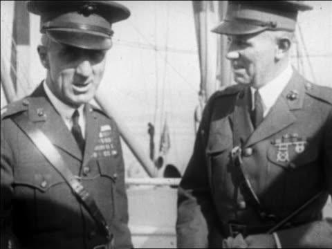 b/w 1927 two military officers in uniform talking laughing outdoors / san francisco / newsreel - 1927年点の映像素材/bロール
