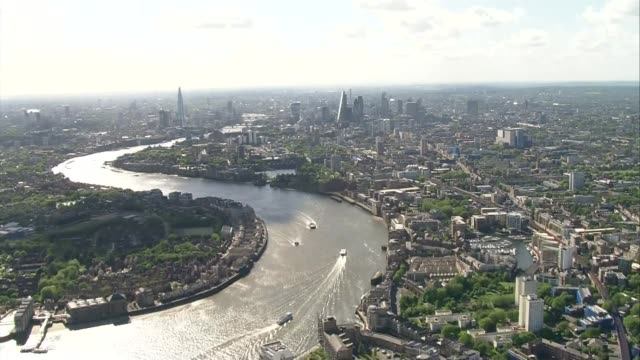 two million households can't get access to high speed broadband; lib london: air view across canary wharf skyscrapers, river thames and other... - speed stock videos & royalty-free footage
