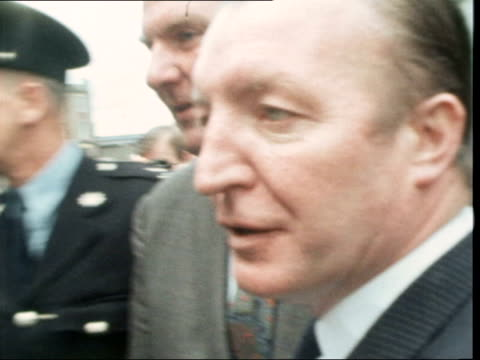 Two ministers charged with arms smuggling released on bail IRELAND Dublin MS Blaney and Haughey RL to car Stands then Haughey LR to car CS Both LR to...