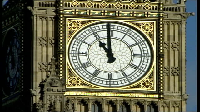 Two minute silence in remembrance of war dead ENGLAND London Westminster MS Face of clock as Big Ben striking 11 o'clock to begin 2 minutes silence...