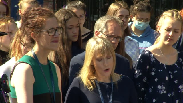 two minute silence observed outside the holt school, where james furlong, who died in reading stabbing terror attack, was a teacher, katie pearce,... - reading stock videos & royalty-free footage