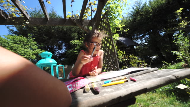 two mixed race sisters do homework on backyard table - crayon stock videos & royalty-free footage