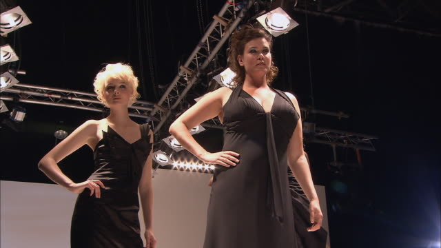 MS Two models, one very thin and one more full-figured, on runway at fashion show/ London, England