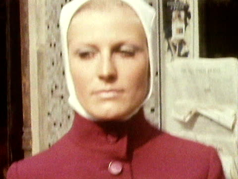 two models pose wearing a hooded jacket and cape coat designed by norman hartnell. 1970 - bloomers stock videos & royalty-free footage