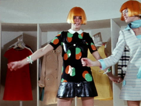 two models sway in a bizarre way whilst wearing orange wigs and patterned mini dresses with long socks 1970 - swaying stock videos & royalty-free footage