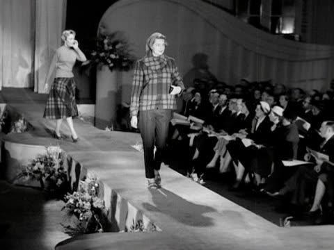 two models walk down a catwalk wearing tartan casual wear 1953 - tartan stock videos & royalty-free footage